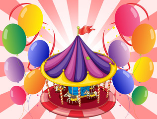 A carousel at the center of the balloons
