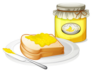 A plate with a bread and a jar of banana jam