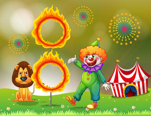 A ring of fire with a clown and a lion at the carnival