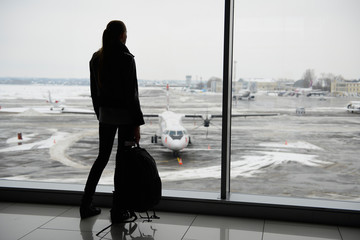 Woman standing in the airport terminal