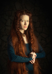 Portrait of woman with long red hair stylized as old picture