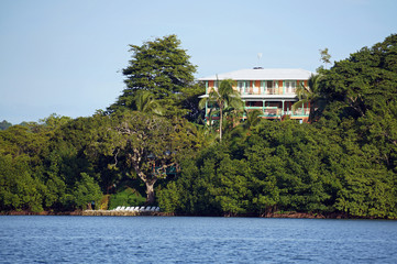 Waterfront hotel with lush vegetation on a tropical island, Bastimentos, Panama, Central America