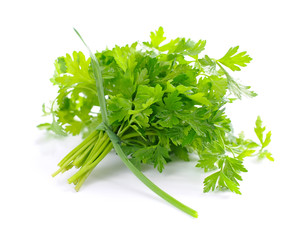 Fresh green parsley and spring onions with grains of pepper