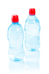 two bottles with water isolated on white