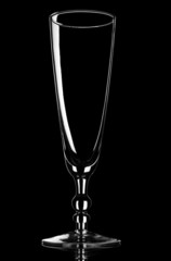 Empty champagne glass on black background