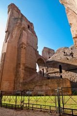 Fototapete - Brick walls ruins and fence on caracalla springs at Rome