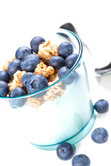 Glass of yoghurt with muesli and blueberries