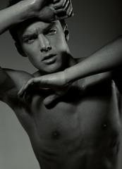 Fotobehang womenART Young guy with a perfect muscle body