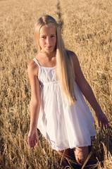 Blond girl walking through the field