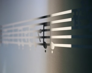 Musical notes on frosted glass, art background