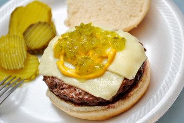 Close-Up of a Cheeseburg with Relish and Mustard