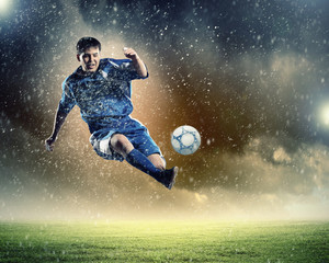 Aluminium Prints Football football player striking the ball