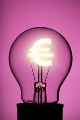 Light bulb with glowing Euro symbol on pink