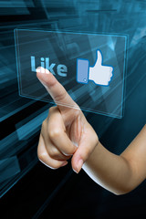 a woman finger select and like  on a english digital screen