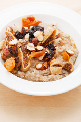 oatmeal with raisins, nuts and maple syrup