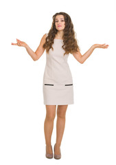 Full length portrait of clueless young woman shrugs