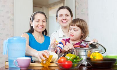 happy women with child  in kitchen