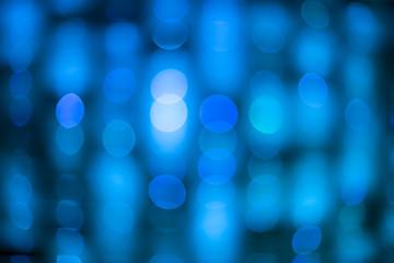 Blue Background of defocused glittering lights