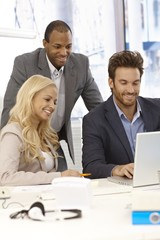 Happy businesspeople working together