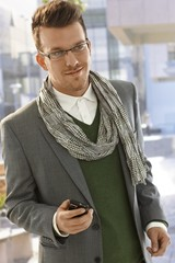 Portrait of young businessman in city