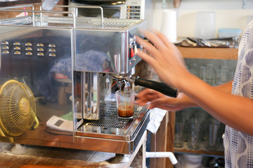 Making a double shot of espresso with intentionally motion-blur