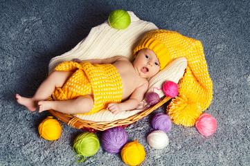 Cute infant baby  inside wicker basket