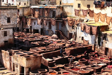 Old tanks of the Fez's tanneries with color paint for leather