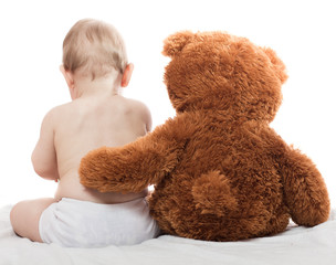 Baby with a soft toy, teddy bear