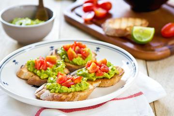 Crostini with avocado and tomato