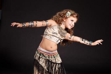 Little girl bellydancer dancing