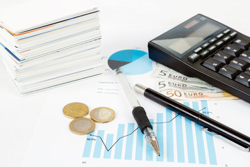 calculator, charts, pen, business cards, money