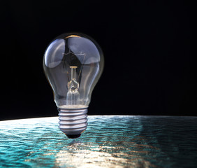 light bulb on blue and black background