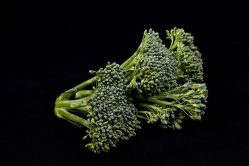 broccoli isolated on black background