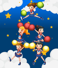 Five cheerdancers dancing with their pompoms