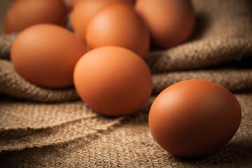 many eggs on burlap background