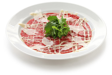 beef carpaccio with parmesan cheese and rucola