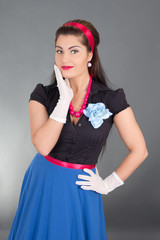 excited brunette woman in retro clothes