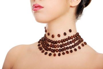 Woman with necklace made frome coffee beans
