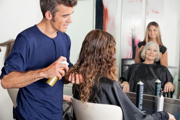 Hairstylists Setting Up Client's Hair