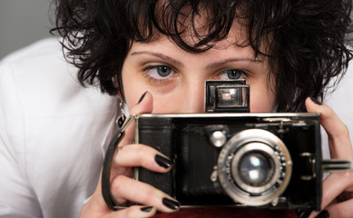 Portrait of a beautiful  woman with a camera classic