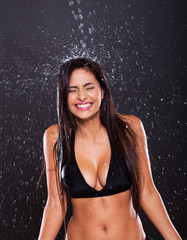 fun woman in water splashes