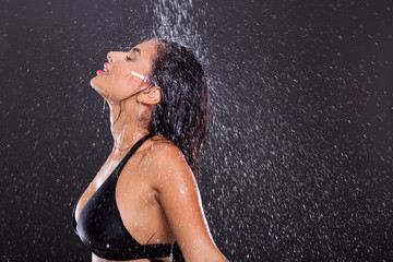 girl posing in water splashes