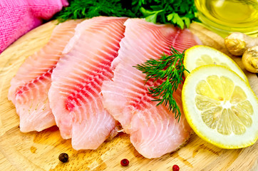 Wall Mural - Fillets tilapia with oil and lemon