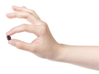 female teen hand holding coffee bean