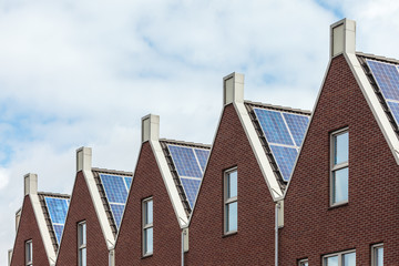 Dutch row of new houses with solar panels