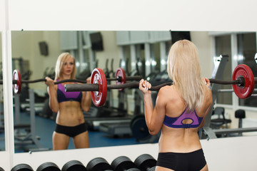 Strong girl lifting heavy weight