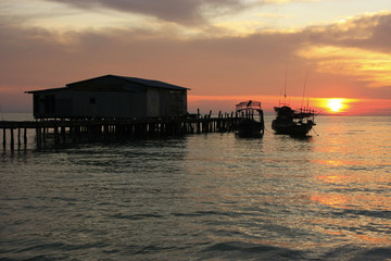 Silhouette of wooden jetty at sunrise, Koh Rong island, Cambodia