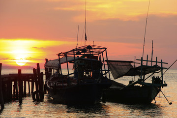 Silhouette of traditional fishing boats at sunrise, Koh Rong isl