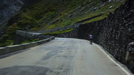 Fototapete - Road travel in Alps. Fast motion.