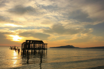 Silhouette of old wooden jetty at sunrise, Koh Rong island, Camb